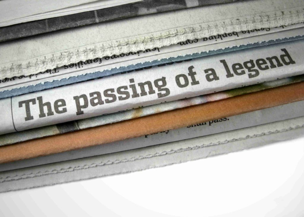 passing of a legend headline on newspaper