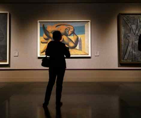 Person looks on at Pablo Picasso painting